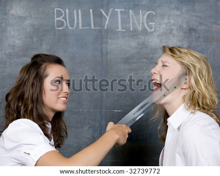 Two Pretty gitrs Abuse each other in front of a chalkboard