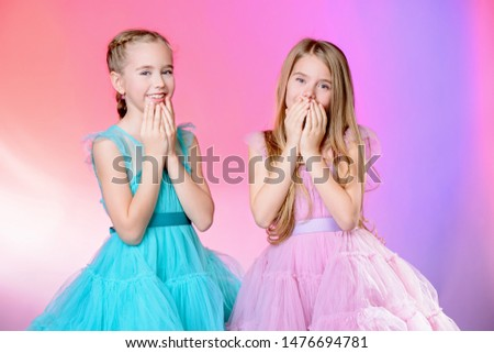 Two pretty little girls dressed in beautiful festive dresses. Kid's fashion concept. #1476694781