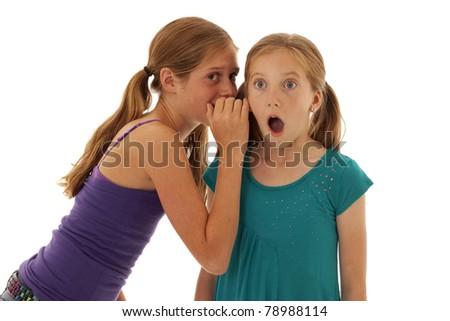 two pretty little girls telling shocking secrets
