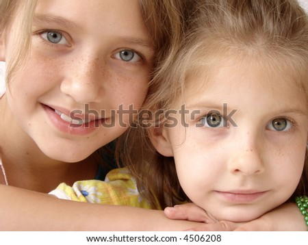 stock-photo-two-pretty-smiling-happy-freckly-schoolgirls-4506208.jpg