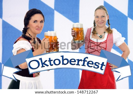 two pretty women in dirndls and beer mug / munich beer festival