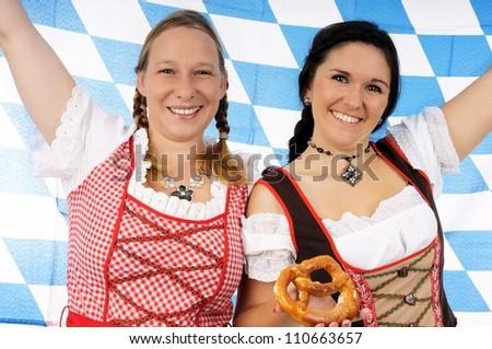two pretty women in dirndls and pretzels / munich beer festival