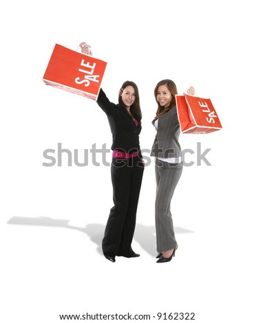 Two pretty women with sale bags looking happy