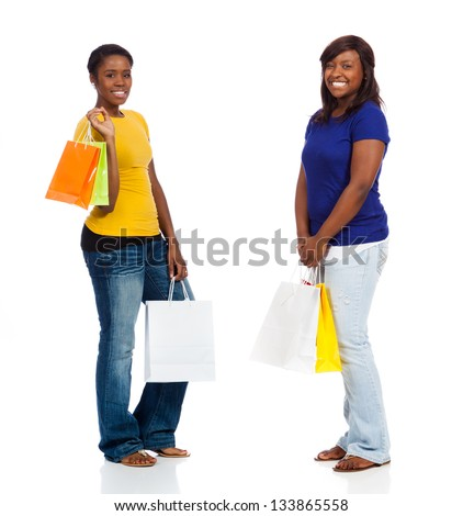 Two pretty, young African American friends with shopping bags on a white background