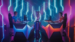 Two Professional Esport Gamers Competition in a Video Game on a Championship Arena, Both Playing Computer Games. Global Online Streaming Cyber Games Tournament