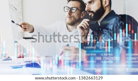Two professional traides looking on technical price graph and indicator, red and green candlestick chart and stock trading computer screen background. Double exposure