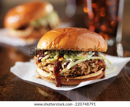 two pulled pork bbq sandwiches with cole slaw