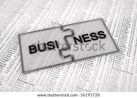 Two puzzle pieces with the term Business on them over stock charts in the newspaper