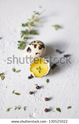 Two quail eggs with thyme