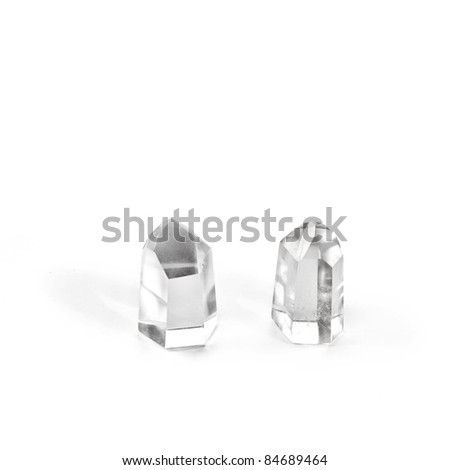 Two quartz crystals on white background.