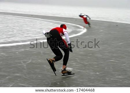 Two racing skaters on the competition