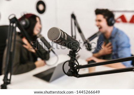 Female presenter or host in radio station hosting show for