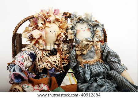 Shutterstock Two rag dolls sitting together on a wood couch.