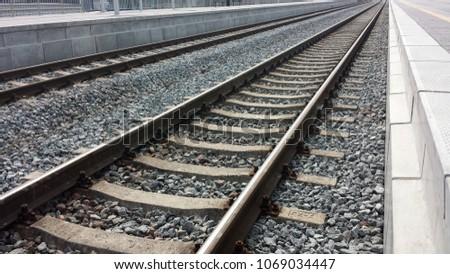 Two railroad tracks between platforms, closeup. #1069034447