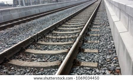 Two railroad tracks between platforms, closeup. #1069034450