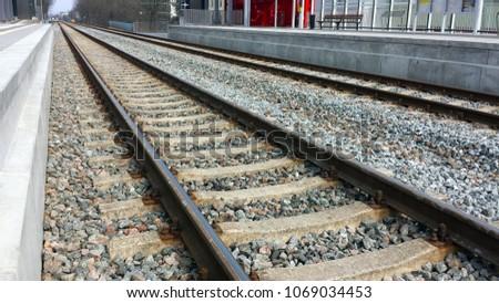 Two railroad tracks between platforms, closeup. #1069034453