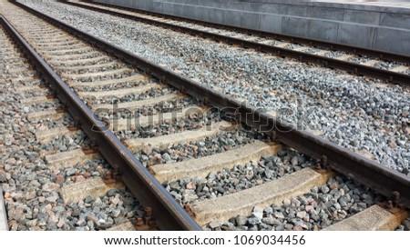 Two railroad tracks between platforms, closeup. #1069034456