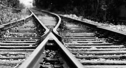 Two railway tracks merge together.
