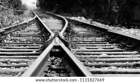 Two railway tracks merge together. #1131827669