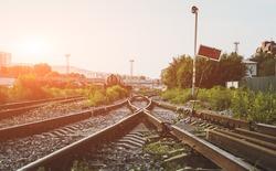Two railways tracks merge close up.Vintage tone.