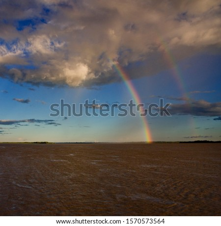 Two rainbows over Amazon River near Cuxiu Muni, Amazon River, Brazil