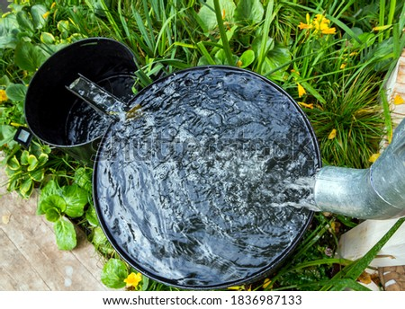 Two rainwater collection tanks with overflow Foto stock ©