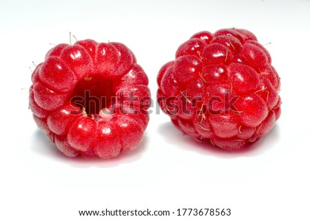 Two raspberries on a white background close up