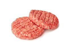 Two raw burger patties on white