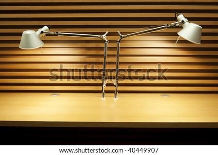 Two reading lamps in empty desktop