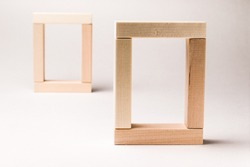 Two rectangular frames at different distances are made up of wooden blocks. Selective focus. Perspective, concept