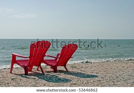 Two Red Adirondack Beach Chairs Sanibel Florida