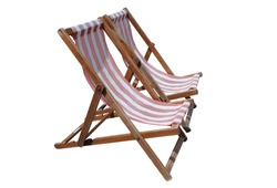 Two red and white striped deckchairs, isolated on white