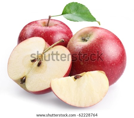 Two red apple with leaf and apple slices isolated on a white background.