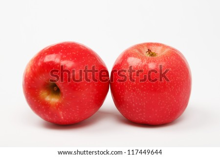 two red apples over white