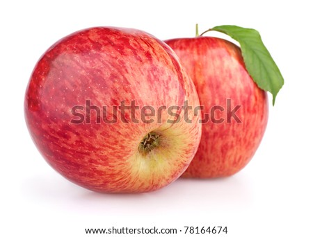 Two red apples with leaf isolated on white background