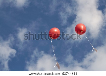 two red balloons in the sky, copy-space, room for text