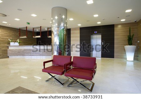 two red chairs in modern lobby