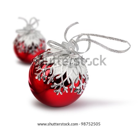 Two red Christmas balls with snowflake decoration, isolated on white