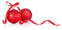Two red Christmas decoration bauble with ribbon bow isolated on a white background