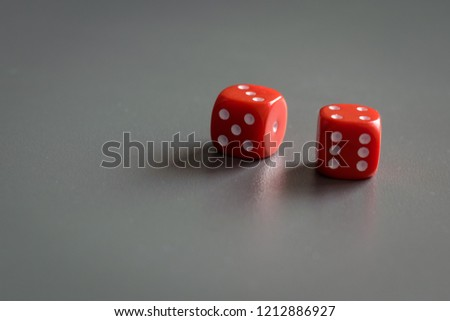 Two red dice isolated on grey background #1212886927