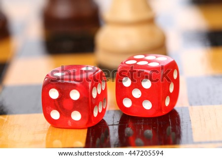 Two red dice on chess board #447205594