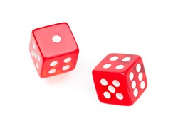 Two red dices moving against a white background