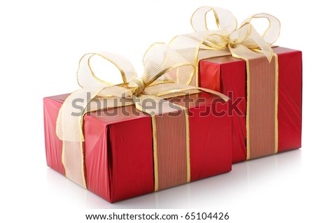 Two red foil gifts with golden bows isolated on white background. - stock photo