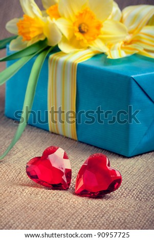 Two red glass hearts with a gift box and flowers, closeup shot, valentine's day/mother's day concept