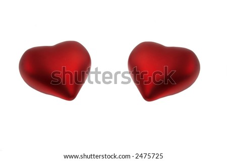 Two red hearts isolated over a white background