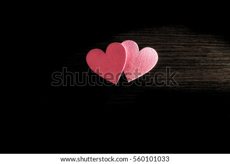 Two red hearts lie on the wooden background  #560101033