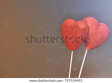 Two red hearts on a black background #797534491