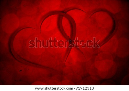 Two red hearts on red bokeh vintage background - Valentine's Day or wedding theme