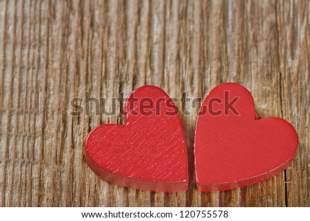 Two red hearts on rustic wooden background with copy space