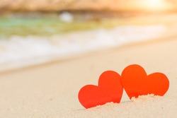 Two red hearts on the summer beach. Love, Wedding and Valentines day concept.